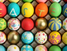 A box of colored eggs - Message: Happy Easter