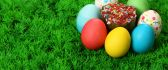 Easter eggs and a cupcake on the grass