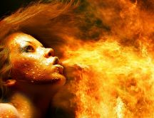 Artistic HD wallpaper - a woman spitting flames