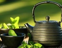 Refreshing mint tea in a teapot