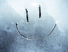 Smiley face on a frozen window