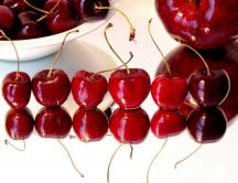 Cherries on a glass table - mirror on the floor