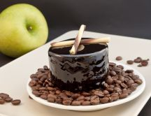 Delicious cake - dark gelatin and coffee beans