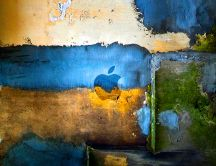 A wall painted in blue, green and yellow - Apple wall
