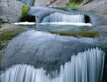 Cool and refreshing water of a waterfall - nature wallpaper