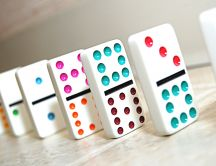 Domino game with colorful pieces