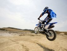 Motorcycle jumping through the desert - Yamaha costume