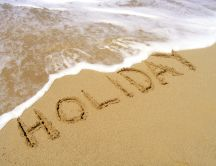 Summer holiday at seaside - message on the sand