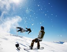 Winter sports on a sunny day - snowboard jumping
