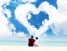 Romantic holiday at seaside - big cloud in heart shape