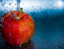 Splash red apple - macro delicious fruit full of vitamins