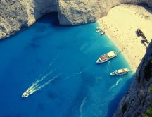 Boat race in Greece - famous beach with golden sand