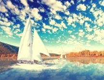 Fantastic blue sky and fluffy clouds - boat on a lake