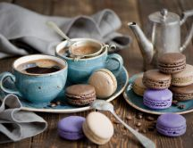 Hot coffee and delicious macarons - perfect breakfast