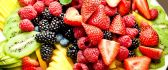 Plate full of healthy fruits - delicious food for dinner