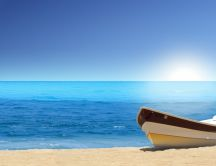 Boat on the beach - beautiful blue sea