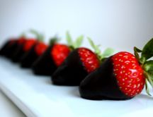 Red strawberries with dark chocolate - delicious dessert