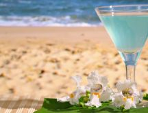 Blue fresh summer cocktail at the beach