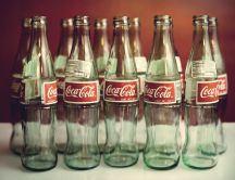 Empty Coca Cola bottles - delicious juice