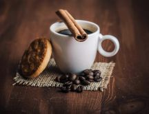 Coffee with cinnamon and one delicious biscuit