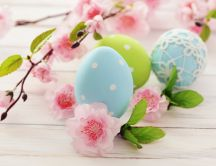 Blue color eggs - Happy Easter Holiday and blossom trees