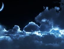 Big fluffy clouds in the dark night