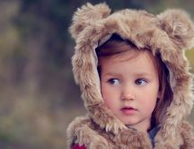 Sweet baby girl with bearskin
