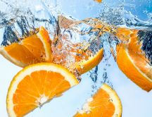 Fresh orange slices in the water
