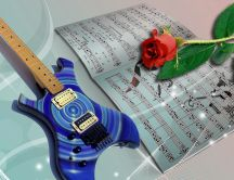 Guitar, red rose and music notebook - Love music