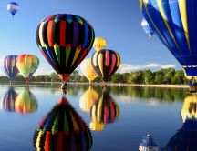 Colored hot air balloons over the lake