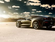 Black Chevrolet Corvette at sunrise