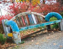 Old and colored bench in a park