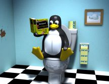 Linux Wallpaper - The penguin reads the magazine