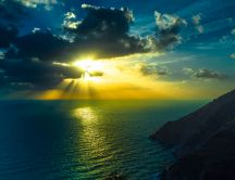 Sunset over the sea - Sunrays between the clouds