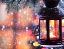 A candle through the snowflakes - Winter time