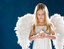 White girl with wings and a candle in hands - Angel girl