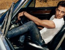 Chris Pine in a convertible car with opened door