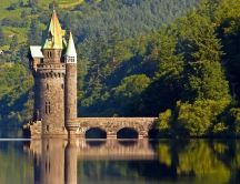 The Vyrnwy Tower on lake water