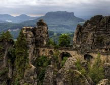 Vintage bridge between rocks - The Bastei Bridge