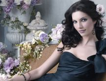 Alana de la Garza between many purple flowers