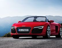 Red Audi R8 Spyder in the mountains