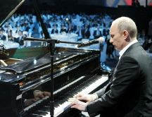 Vladimir Putin playing piano in a concert