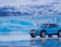 Beautiful blue Volkswagen car on the ice - winter wallpaper