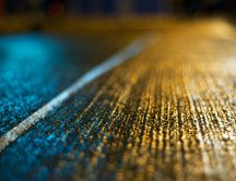 Beautiful texture on the road in the blue and yellow light