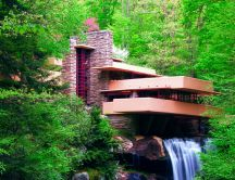 Modern house in the middle of the forest - waterfall inside