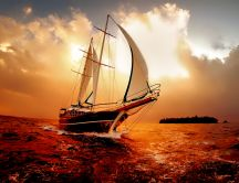 Boat on the ocean in the sunset - wonderful colors