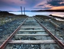 Old and rusty rails go on the sea - HD wallpaper