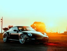 Black Porsche in the sunset - HD auto wallpaper
