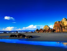 Wonderful blue water and big rocks - beautiful wild beach