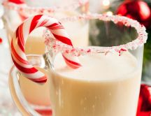 Glass of milk with sugar and candy - Christmas drink